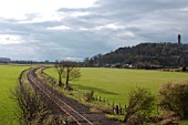 The Stirling to Alloa disused branch line in Scotland. View from road bridge looking to Stirling. April 2005.