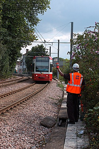 A work gang acknowledge a passing tram September 2005