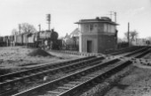 Murrow was located on the GER/GN joint line from Lincoln to March. In this scene, looking north, it is crossed by the M&GN route and the Down goods, running east to South Lynn, is headed by Ivatt 2-6-0 No.43081, a Neasden engine. The date is 28th February 1959. In their heyday, these engines successfully worked all the M&GN line traffic ftrom Leicester and Peterborough in the west to Norwich and Yarmouth in the east. Note the BR Arp type signal-box with its thick concrete roof. These reinforcements were built in the war years to render the boxes less suseptible to aerial damage.