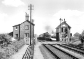 Heckington looking east with a typical GNR signal-box and somersault signal. The train is the 2.39 Skegness to Birmingham on July 27th 1963. It is worked by Ivatt 2-6-0 No.43108 bearing a 40E, Langwith Junction shed-plate.