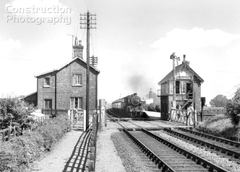 Heckington looking east with a typical GNR signalbox and somersault signal The train is the 239 Skeg