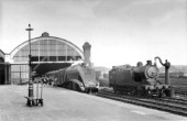 Darlington station looking north from the southend of the Up main platform on 10th October 1953. Gresley A4 Pacific No.60006 Sir Ralph Wedgewood heads The Northumbrian alongside one of the lovely A8, 4-6-2Ts which were a Gresley rebuild of Ravens D Class 4-4-4Ts