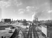 Ashchurch on the MRs Bristol to Birmingham main line looking north. This station is now demolished and replaced by a two platform halt almost devoid of shelter. C1960