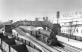 Kirkby Bentinck was the nearest station to Mansfield on the Great Central Main Line. Here, in winter conditions, a Sheffield Darall B1 Class No. 61041 passes with an Up train. 26th February 1955.