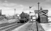 Lostock Gralam, on the former Cheshire Lines Committees railway, with an LNER Class O2, 2-8-0 passing the signal. Note also the Head Shunt to the adjacent goods yard. c1960