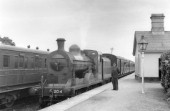 Irish Railways Class J12, 4-4-0 Antrim with a train at an unknown station in Ireland. C1953.