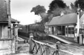 Ketton and Collyweston station in Rutland, Englands smallest county. A Stanier 8F steams through with a rake of freight empties. c1960
