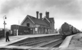Gedling station on the Great Northern Railway in Nottinghamshire with a K3 Class at the head of a freight train passing through. C1960
