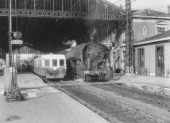 Narbonne station on the Midi cross-country line from Bordeaux to Marsailles and is the junction for the Spanish frontier via Perpignan. On the right is a long distance train hauled by a versatile Class 141R whilst on the left is an Autorail diesel unit with a local service. 15th April 1963.
