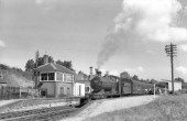 A Collett 251 class 0-6-0 stands in Pensford, Great Western station with the 10.20 Bristol to Frome train via radstock on 22nd August 1957. The engine is No 2213 allocated to 82B - Bristol, St Philips Marsh. These engines were the successors to the famous Dean Goods 0-6-0s which, in actuality, were mixed traffic engines. Pensford was approximately 7 miles from Bristol and 18 miles from Frome.