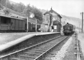 Ex-GW 0-6-0PT No. 9776 waits with a Toad brakevan for 0-6-0PT No. 3661 at the head of a Newport to Brecon passenger train to clear the section at Pentir-Rhiw by exchanging tokens. This station, on the former Brecon & Methyr Railway, was a block post and passing place, with an island platform on the steepest run on a British main line, where trains were lifted from Talybont-on-Usk to Torpantau.