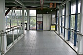 Pedestrian access bridge at Smethwick Galton Bridge station, West Midlands showing lift entrance and staircase. 2007