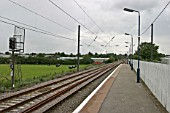 General platform view of Lichfield Trent Valley station, Staffordshire, showing signal and platform lighting. 2007
