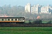 A slam door set 4 Vep in Connex livery passes the medieval magnificence of Arundle castle in Sussex with a Connex South Central train service. 2003