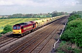 A class 60 EWS locomotive is seen here hauling ARC stone wagons at Cossington, Leicestershire. 23rd April 1998.