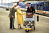 A helping hand for elderly passengers at Waterloo station in London. C1992