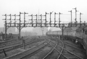 Semaphore signal gantry, Preston taken from a northbound train. C1955