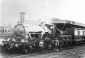 The last up (London Bound) GWR Broad Gauge mail train from Plymouth hauled by Rover Class 4-2-2 Bulkeley taking water at Didcot. 20th May 1892
