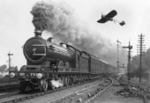 A North Eastern Railway Z1 Atlantic caught on film with a low flying monoplane during the early years of the twentieth century - the shape of thing to come. c1915