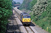 A Class 56 diesel electric at the head of an agregate train passes milepost 92½ on the Midland Main Line. C 1993