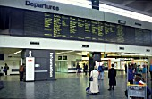 Concourse and annunciator board at Euston station, London C 1992