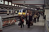 Passengers leaving a train newly arrived from the north at Euston station, London. C 1999