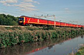 A Royal Mail train heads north along side the Oxford canal at Ansty. 2003