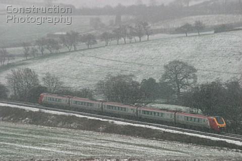 A Virgin Trains Voyager heads south through the Derwent Valley on a cold winters day during 2004