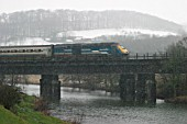 A Midland Mainline operated HST heads north across the river Derwent through the Derwent Valley on a cold winters day during 2004.