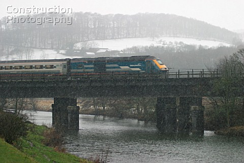 A Midland Mainline operated HST heads north across the river Derwent through the Derwent Valley on a