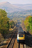 A Midland Mainline HST Rio service passes through the Hope Valley in the Peak District National Park. Here it is seen heading south near Hope. Loose Hill can be seen in the background. 2004