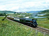 The Bon Accord. No.60009 Union Of South Africa skirts Lindores Loch near Newburgh en route to Perth to Edinburgh. 05.07.1986.