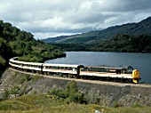 West Highland Line. No.37401 Mary Queen of Scots at Loch Dubh with the West Highlander en route from Mallaig to Fort William. 28.08.1988.