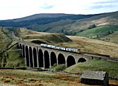Arten Gill Viaduct. The 10:30 ex Carlisle heads south over Arten Gill Viaduct. 04.05.1987.