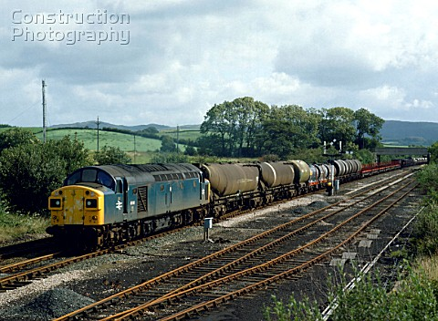 Plumpton Junction Ulverston No40140 heads west for Ulverston with a mixed freight 25882